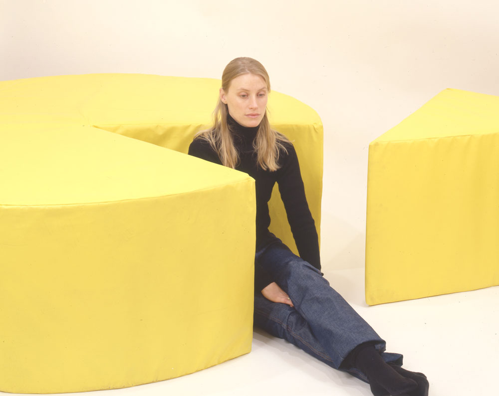 Hanna Schouwink taking a moment in Jason Rhoades's installation Cheese (1999), on view in the exhibition Jason Rhoades and Paul McCarthy: Propposition at 43 Greene Street in New York, dated 1999.