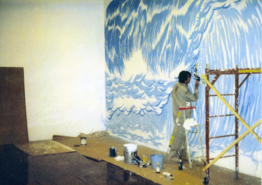 A photograph of Raymond Pettibon working on the wall drawing No Title (Well you needn't . . . ) (1997) for his second gallery solo show, Raymond Pettibon at 43 Greene Street in New York, dated 1997.