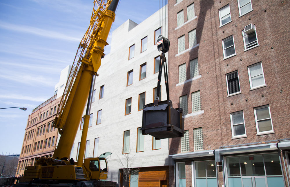 Richard Serra's sculpture Equal (2015) being craned into 537 West 20th Street in New York, for the exhibition Richard Serra: Equal, dated 2015.
