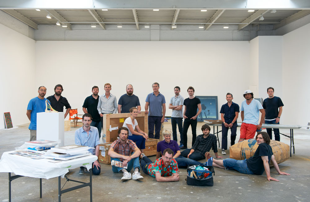 artists during the installation of the exhibition People Who Work Here at 519 West 19th Street in New York, dated 2012.