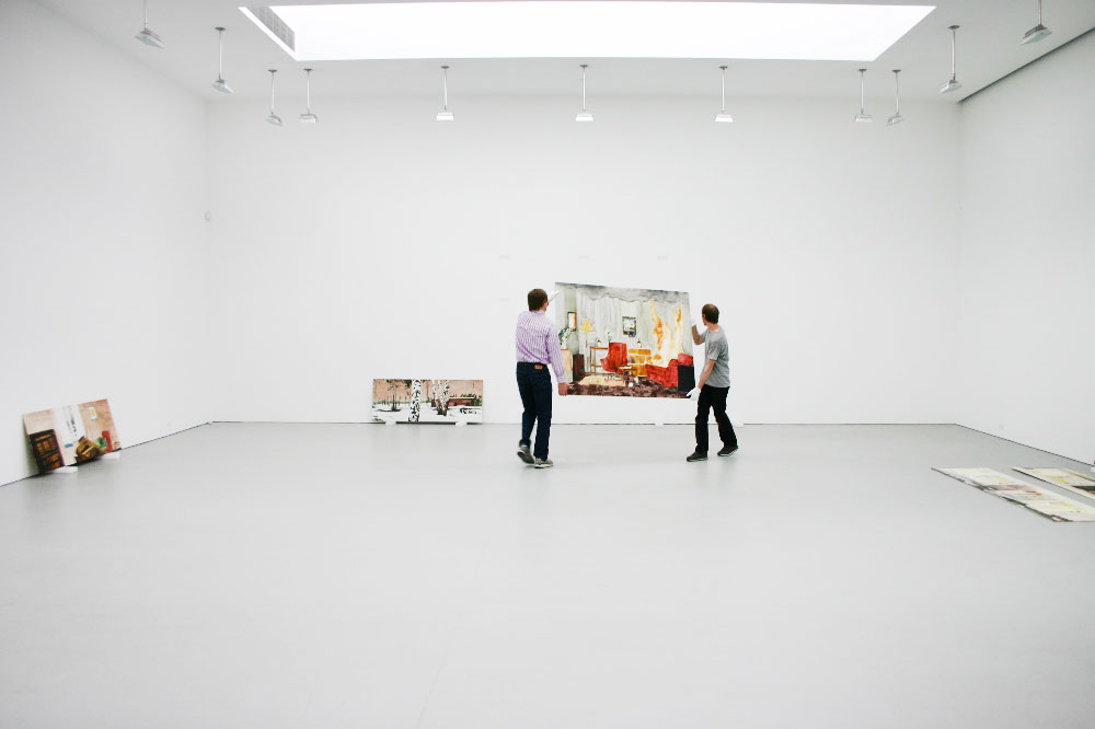 David Zwirner helping to install the exhibition, Mamma Andersson: Rooms Under the Influence, at 525 West 19th Street in New York, dated 2006.