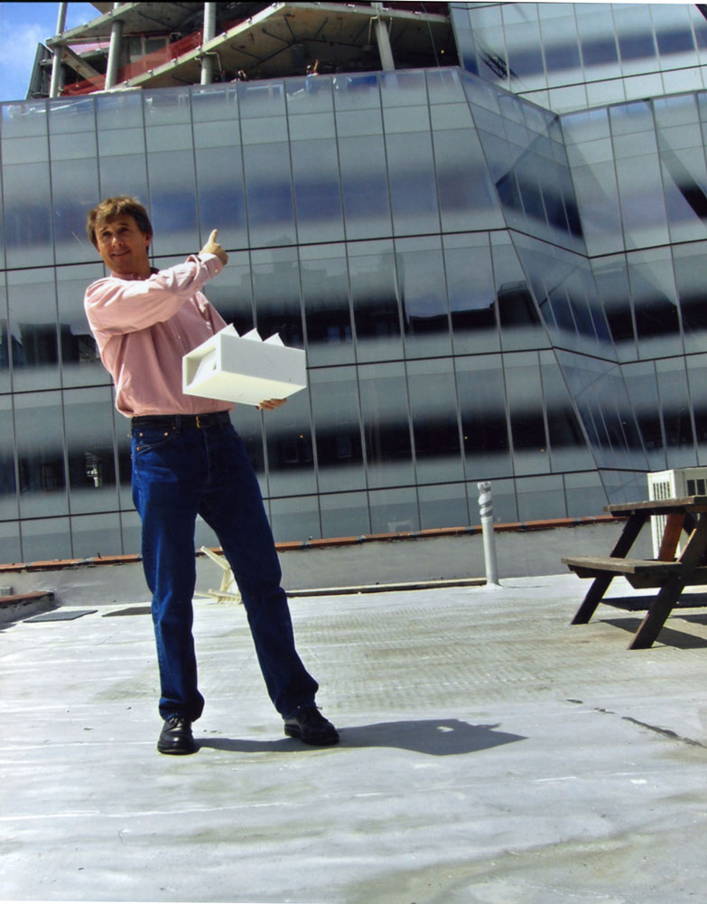 David Zwirner on the roof of 525 West 19th Street in New York, holding a scale model of the new gallery space at 533 West 19th Street, circa 2006.