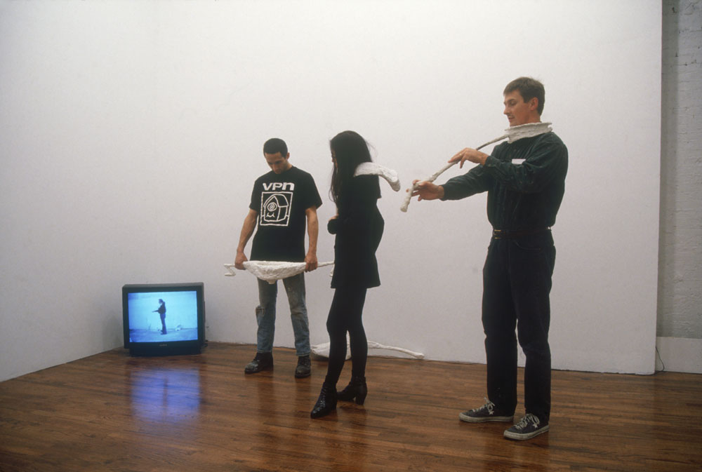 David Zwirner and gallery staff, including Angela Choon, interacting with Franz West's sculpture Passstücke (1983 to 1994), on view in the exhibition Mike Kelley; Paul McCarthy; Bruce Nauman; Franz West, dated 1995.