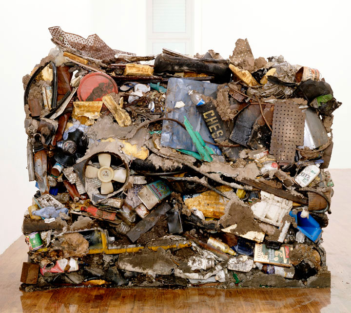 An installation by Gordon Matta-Clark, titled Garbage Wall (dated 1970), on view in the exhibition Gordon Matta-Clark at 43 Greene Street in New York, dated 1999.