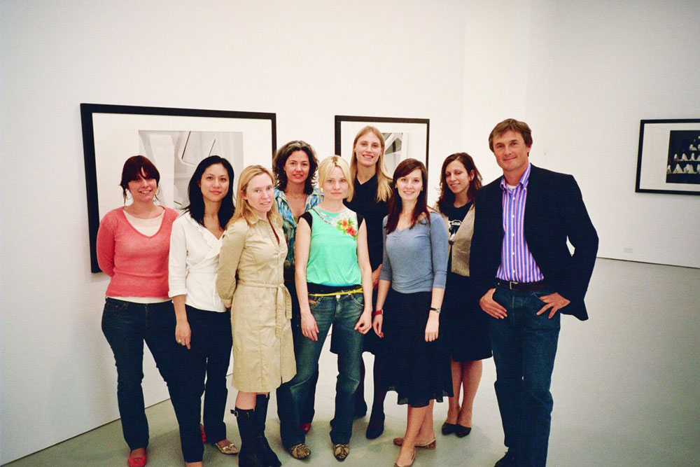 David Zwirner with gallery staff at the exhibition James Welling: New Work at 525 West 19th Street in New York, dated 2005.