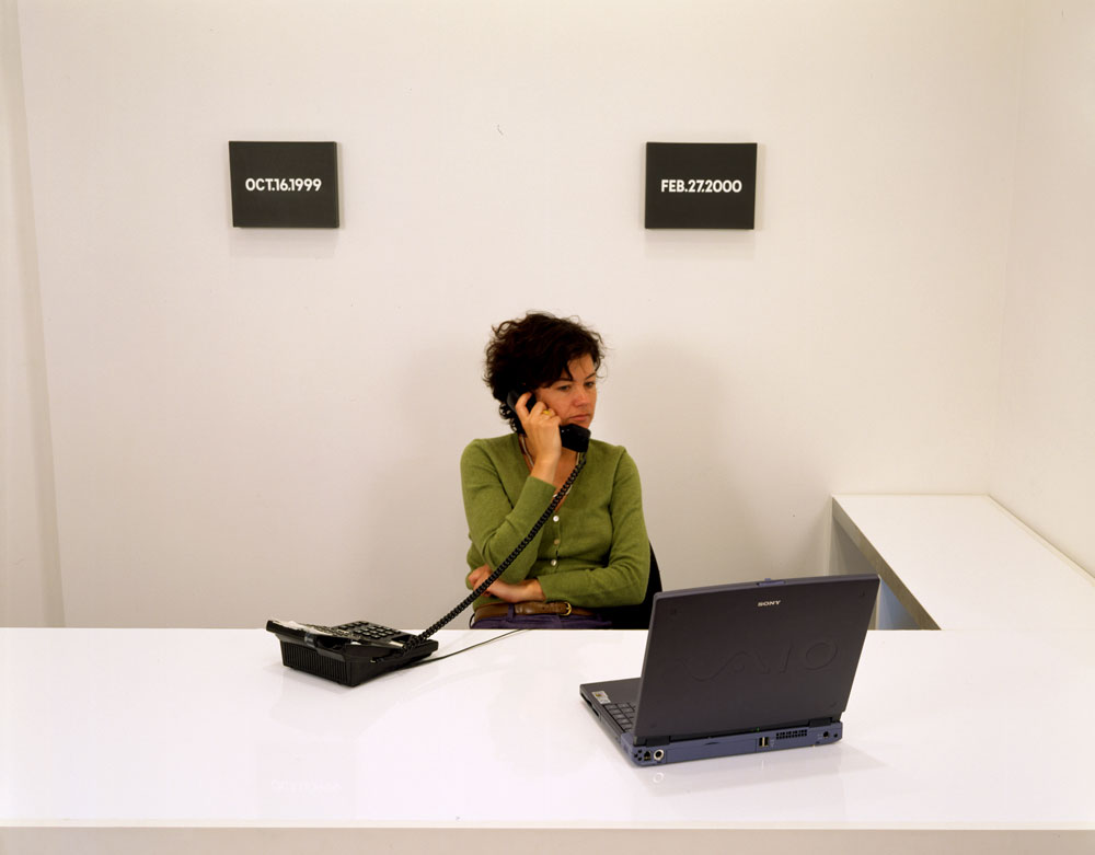 Bellatrix Hubert working in back office, with On Kawara's date paintings, on view in the exhibition On Kawara: One Million Years (Past and Future) at 43 Greene Street in New York, dated 2001.