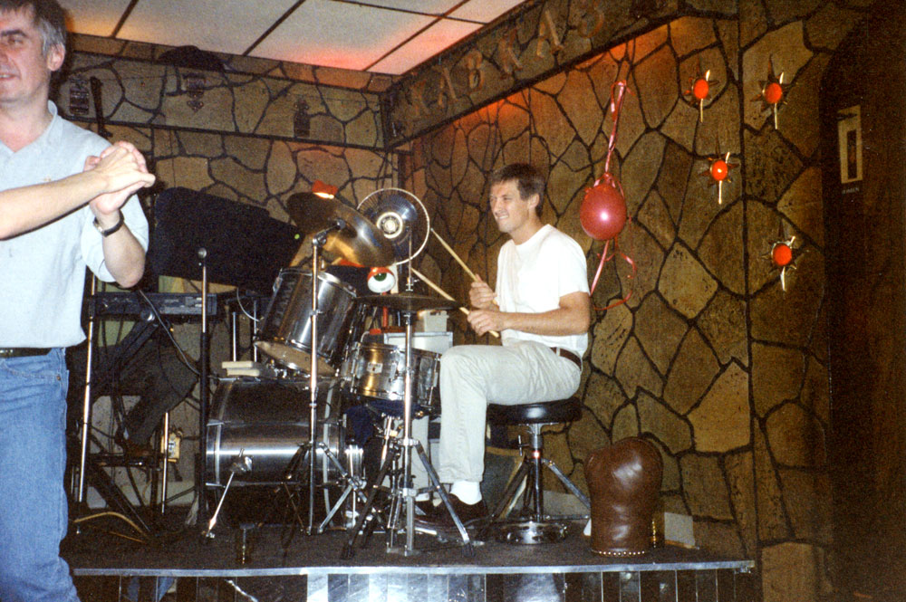 Peter Pakesch dancing and David Zwirner playing drums at a Russian restaurant in Coney Island, following a Franz West show opening, dated 1994.