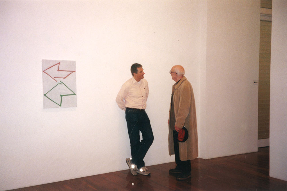 David Zwirner sharing a moment with Raoul De Keyser at the artist's first gallery solo show, Raoul De Keyser: Come on, play it again, at 43 Greene Street in New York, dated 2001.