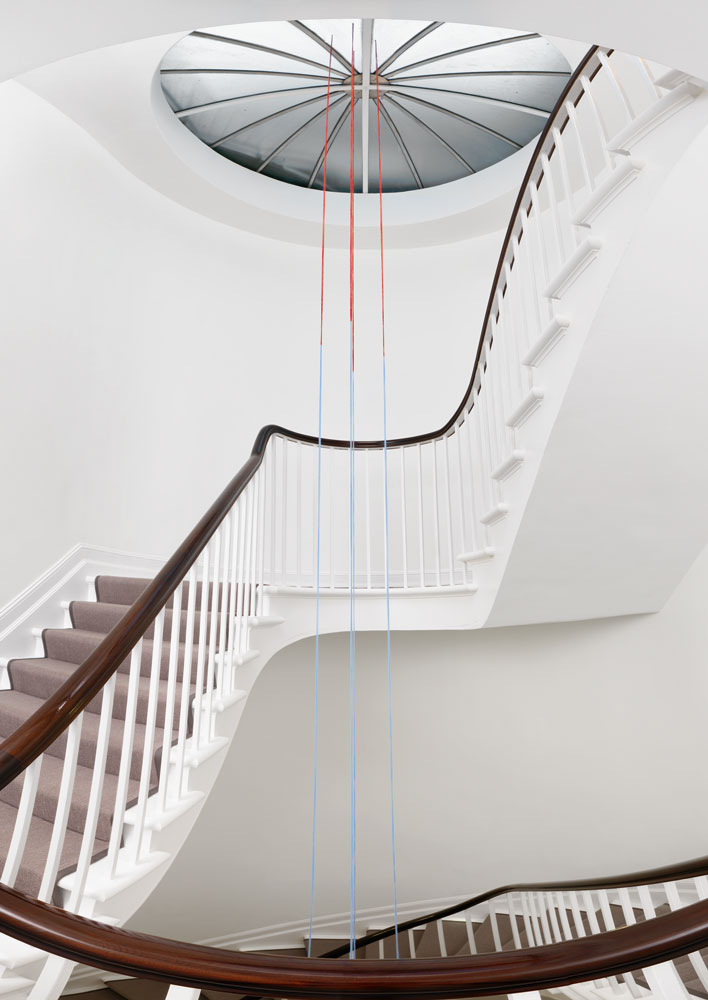 Fred Sandback's installation Untitled (Four-part Vertical Construction) (dated 1988) installed in the staircase of 24 Grafton Street in London, for Fred Sandback, dated 2013.