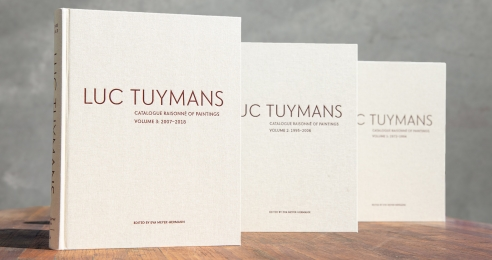 A photo of Luc Tuymans Catalogue Raisonné of Paintings, volumes 1, 2, and 3.