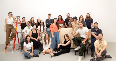 A group photo of the artists whose work is featured in the exhibition, People Who Work There, New York, dated 2019.