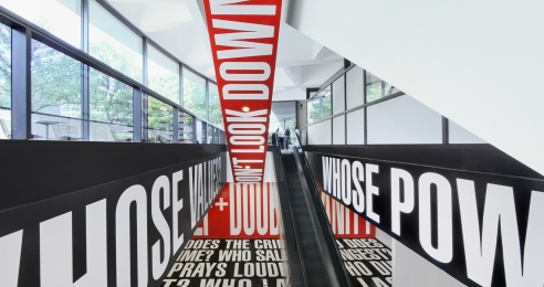 An installation view of an exhibition titled, Barbara Kruger: Belief + Doubt, at the Hirshhorn Museum and Sculpture Garden, Washington, DC, dated 2012-ongoing.