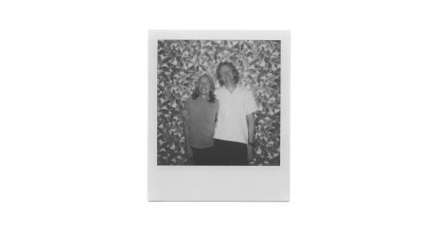 A polaroid photo of Eileen Myles and Flavin Judd in 2019.