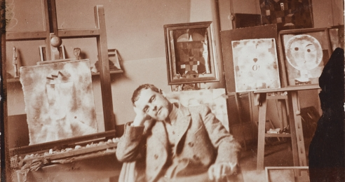 A photo of Paul Klee in his studio at the Bauhaus in Weimar, dated 1923.