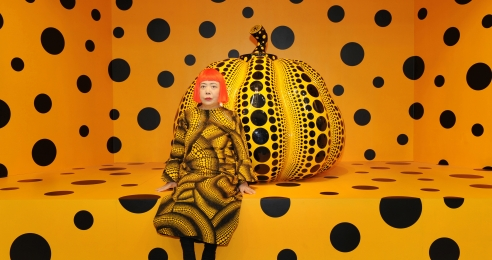 A photograph of Yayoi Kusama with a Pumpkin sculpture, dated 2010.
